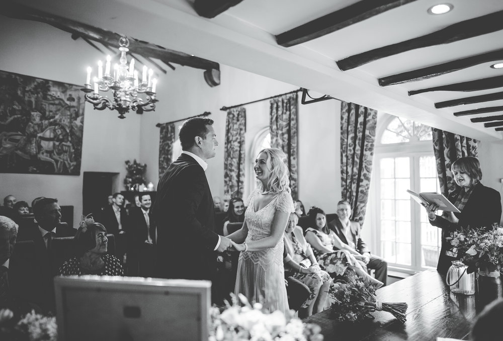 Black and white photograph of the bride and groom during the wedding ceremony- Relaxed wedding photographer in the lake District.