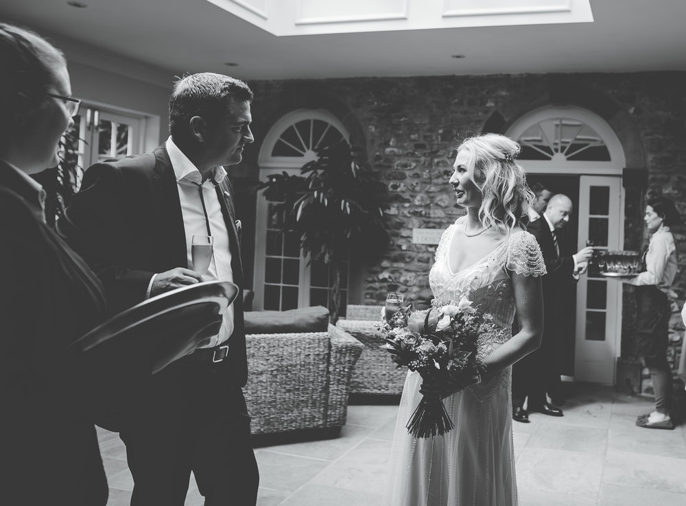 The bride and one of the wedding guest- Black and white candid wedding photography