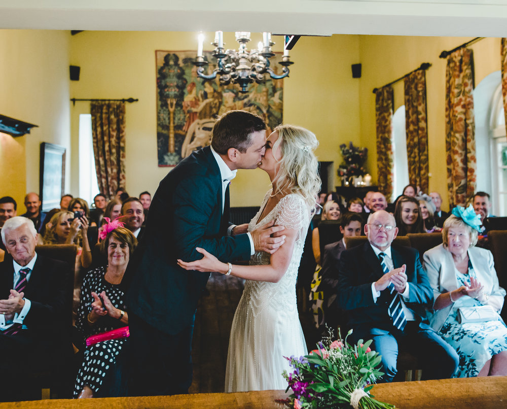 The groom kissing his bride- Documentary photography at Hipping Hall Kirkby Lonsdale