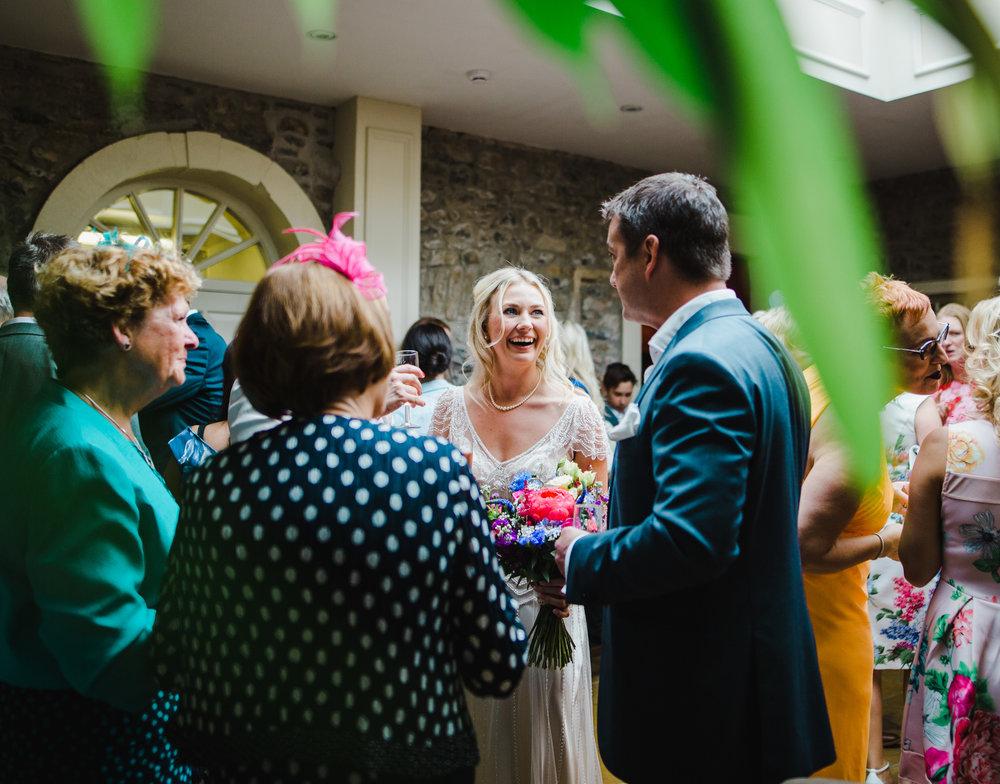 Documentary wedding photograph of the guests laughing
