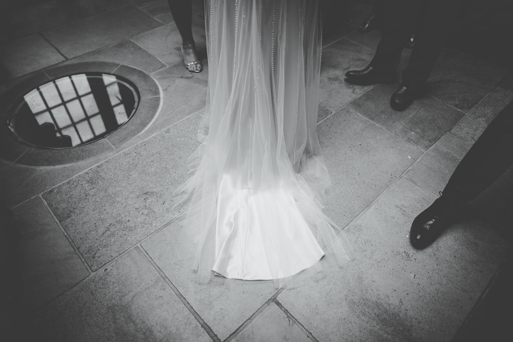 The bride trail of her dress- black and white wedding photography