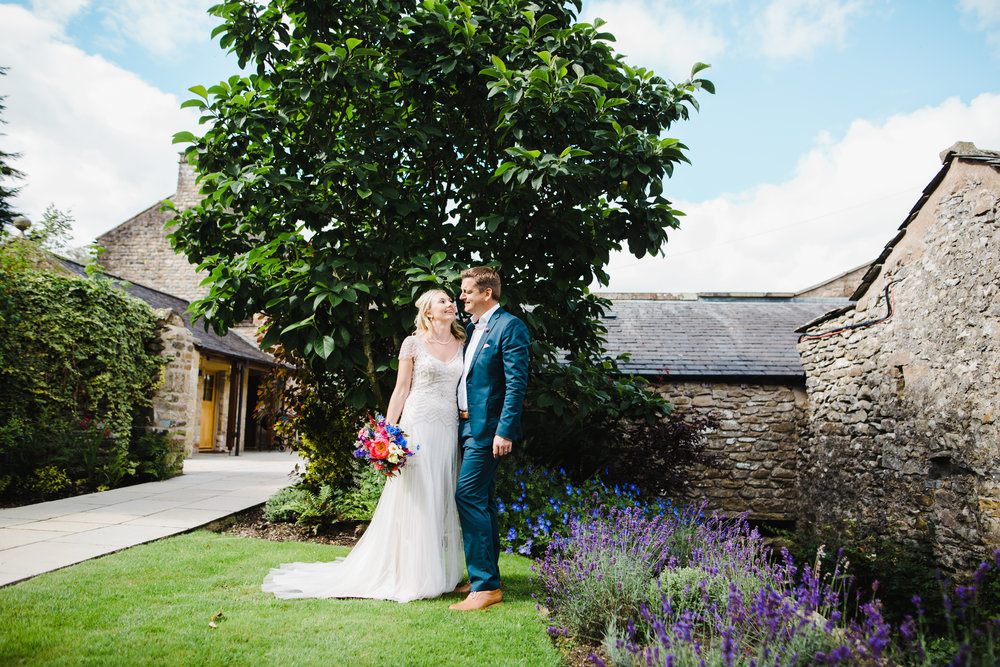 The bride and groom outside their wedding venue of, hipping hall, lake district