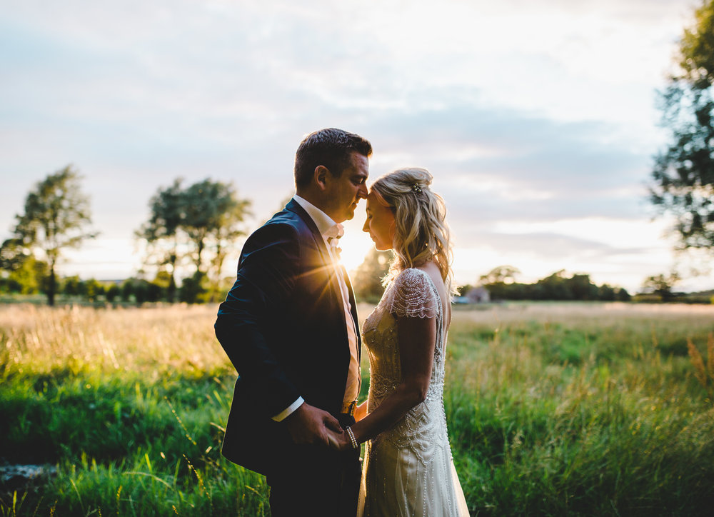 The bride and groom amongst the sunset- Creative wedding photography