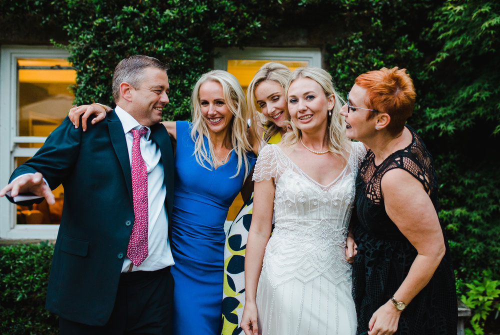 The bride with her wedding guests- Intimate wedding at the lake district