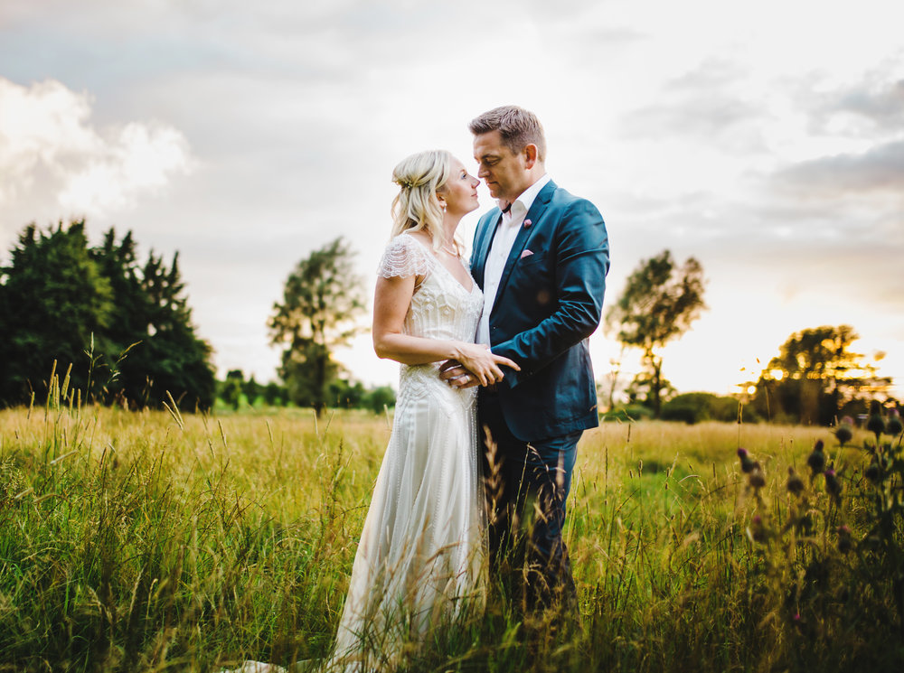 The bride and groom in the fields of Hipping hall- Creative photography