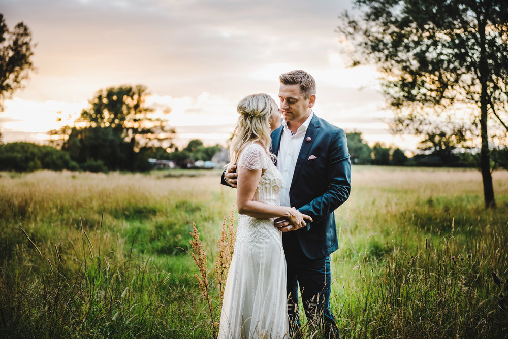 The bride and groom looking into one another eyes as the sunsets- creative wedding photography