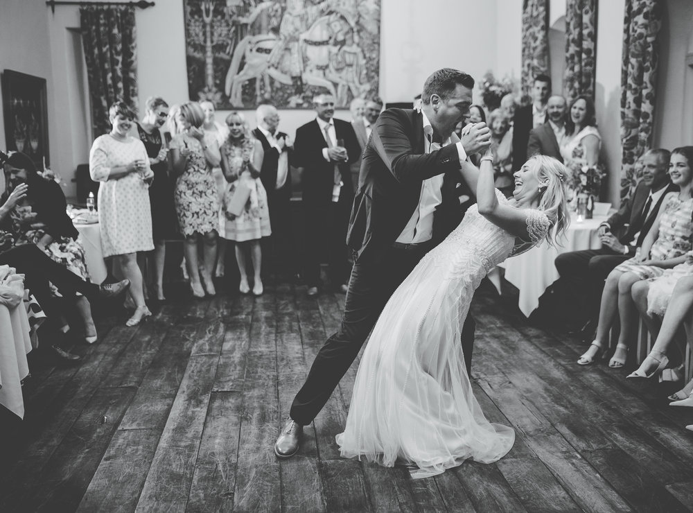 The bride and groom showing off on the dance floor- Black and white documentary wedding photograph