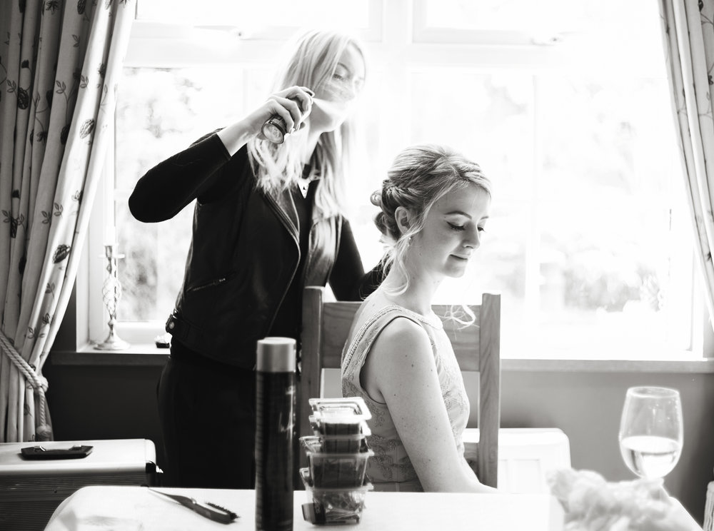 Black and white photograph of the bride having her hair done- Creative photography