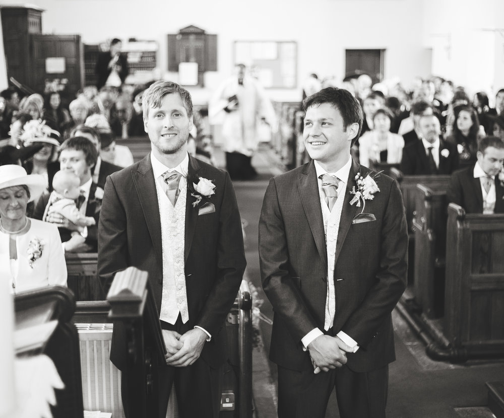 Black and white photograph od the groom and his best man waiting at the alter- Lancashire wedding photography