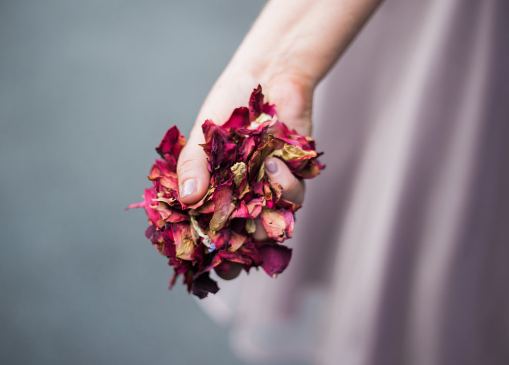 Wedding confetti in the hand of a bridesmaid- creative fun wedding photography