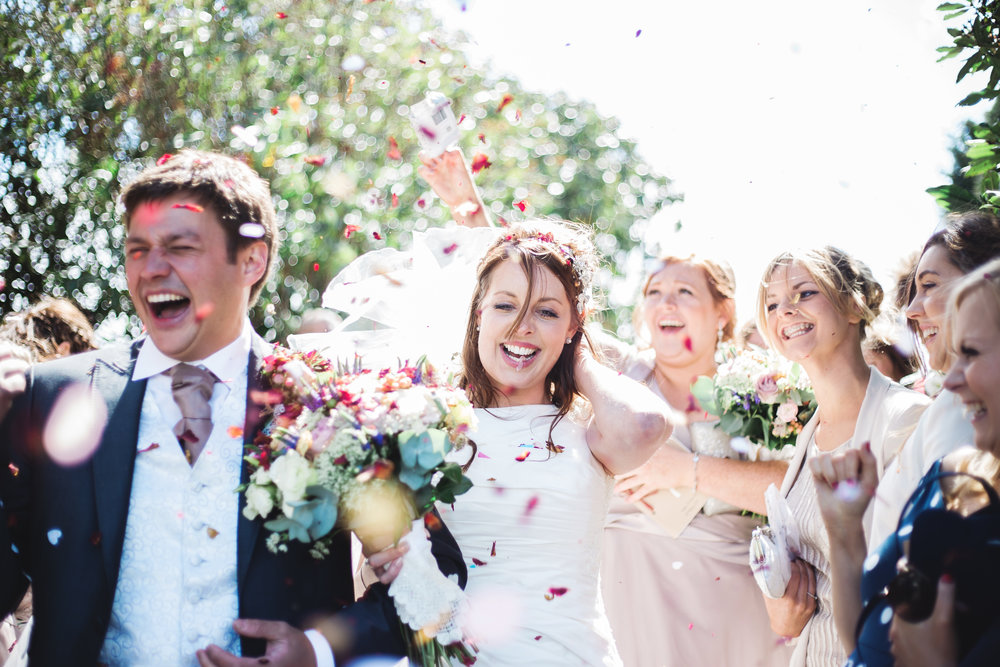 Walking through air filled with confetti- Handcrafted wedding