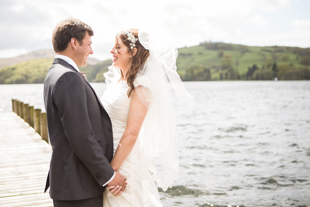 Portrait of the bride and groom along the lake at the lake district.