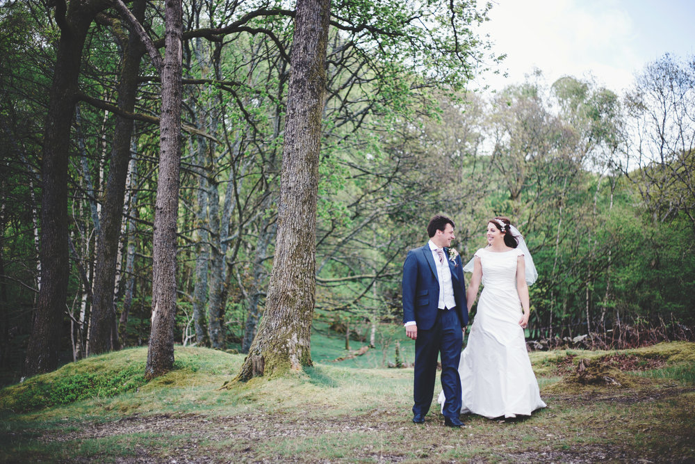 The bride and groom looking into one another eyes in the woodland- Creative wedding photography, lake district