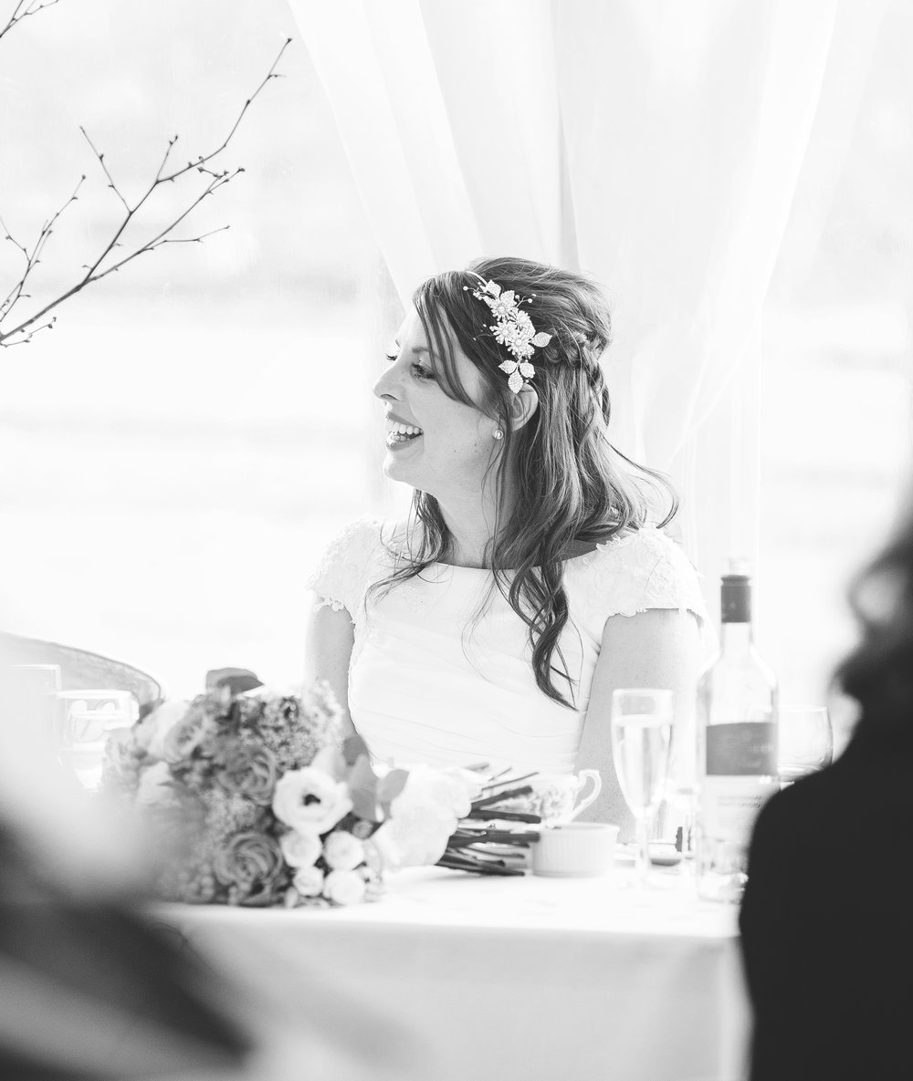 candid photo of the bride at the table- Fun relaxed wedding