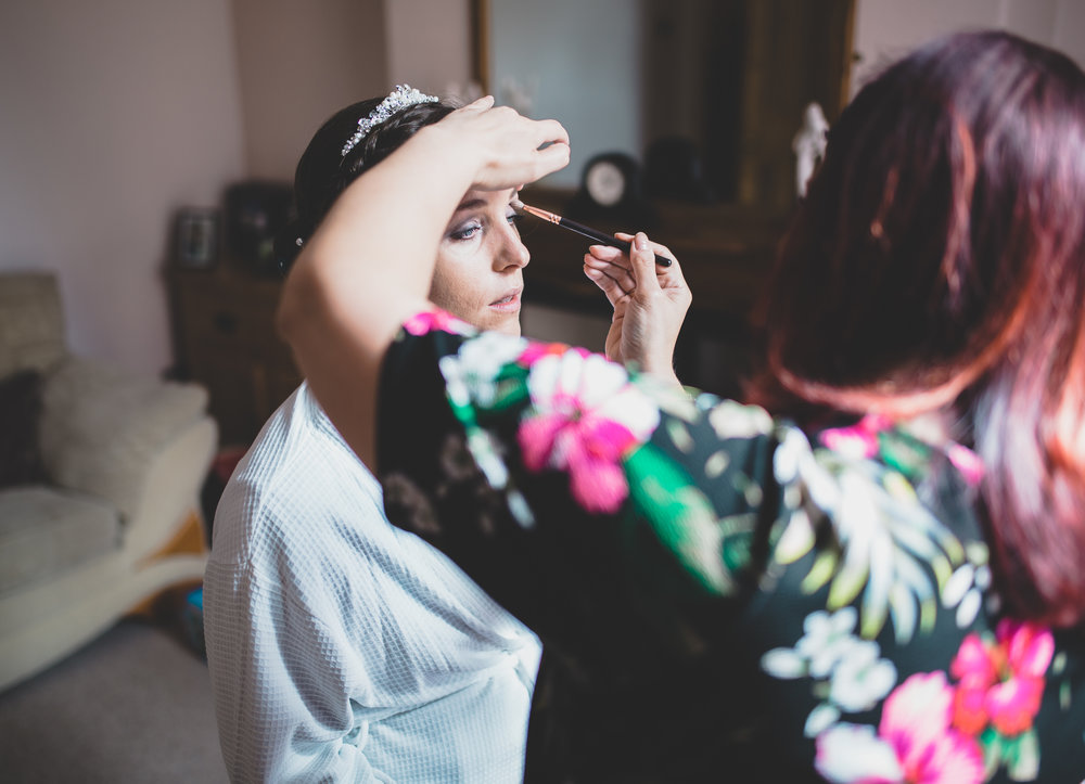 Bride getting her makeup done for her big day- wedding at The Villa at Wrea Green in Preston
