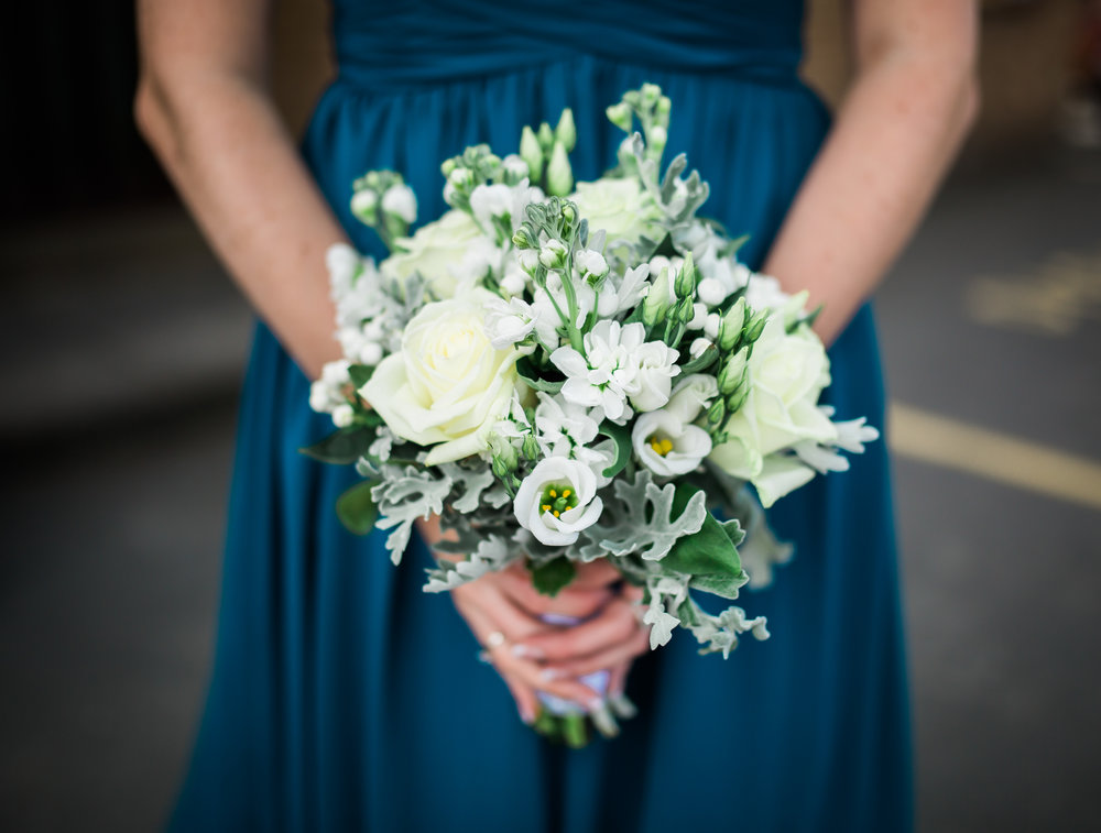 Bridesmaid holding the flower bouquet- relaxed wedding photography