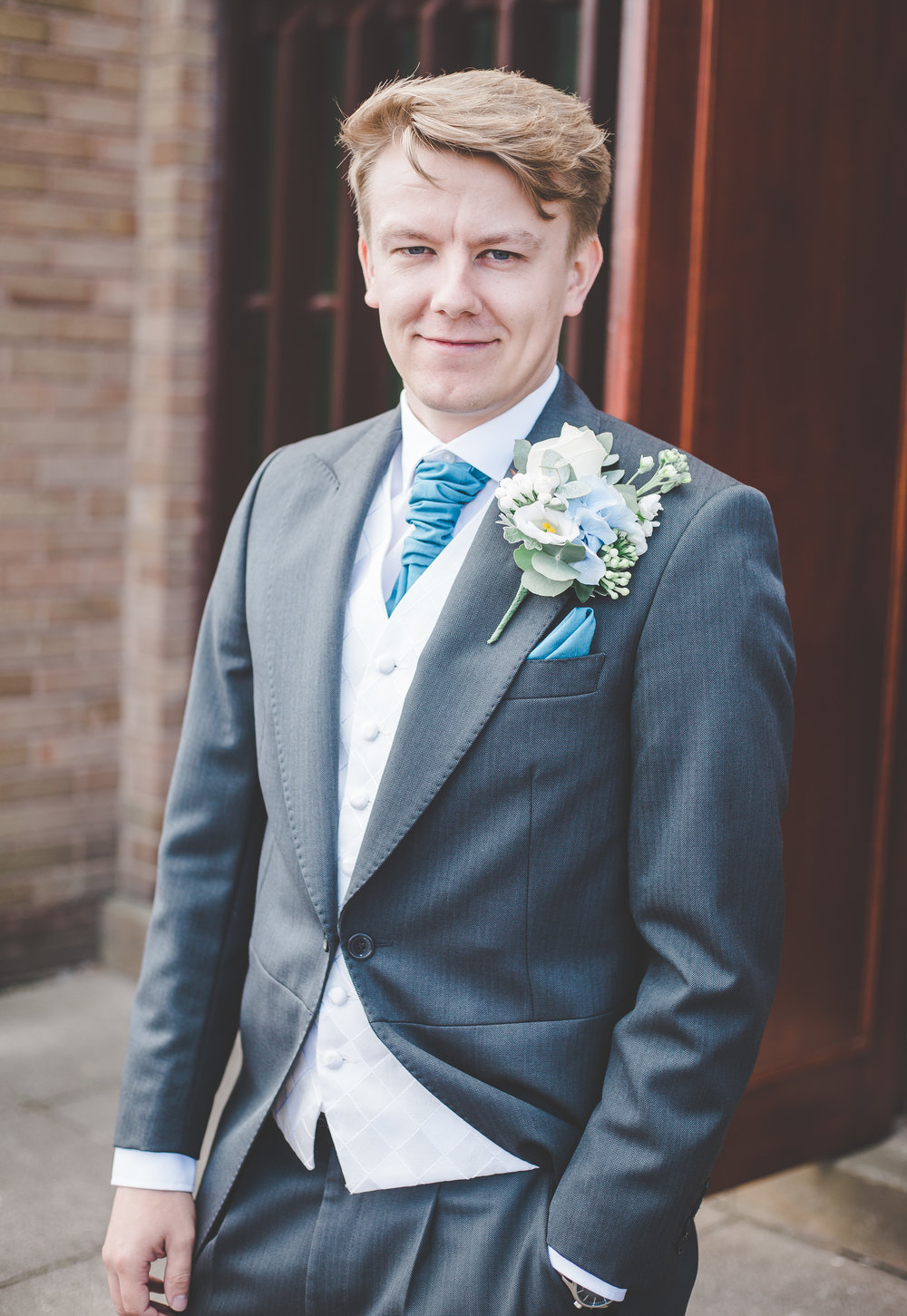 Portrait of the groom outside of The Villa at Wrea Green Preston