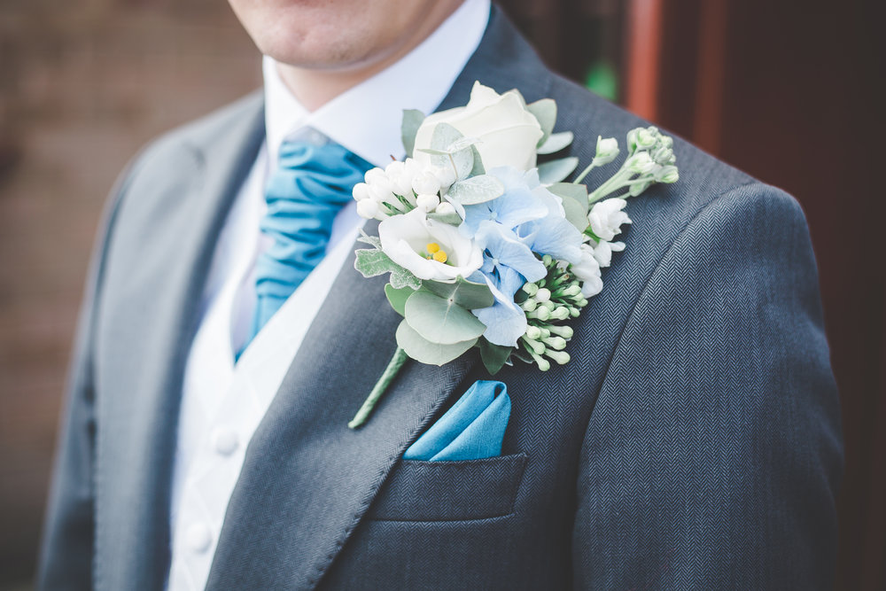 Close up of the grooms button hole flower- The Villa at Wrea Green Preston