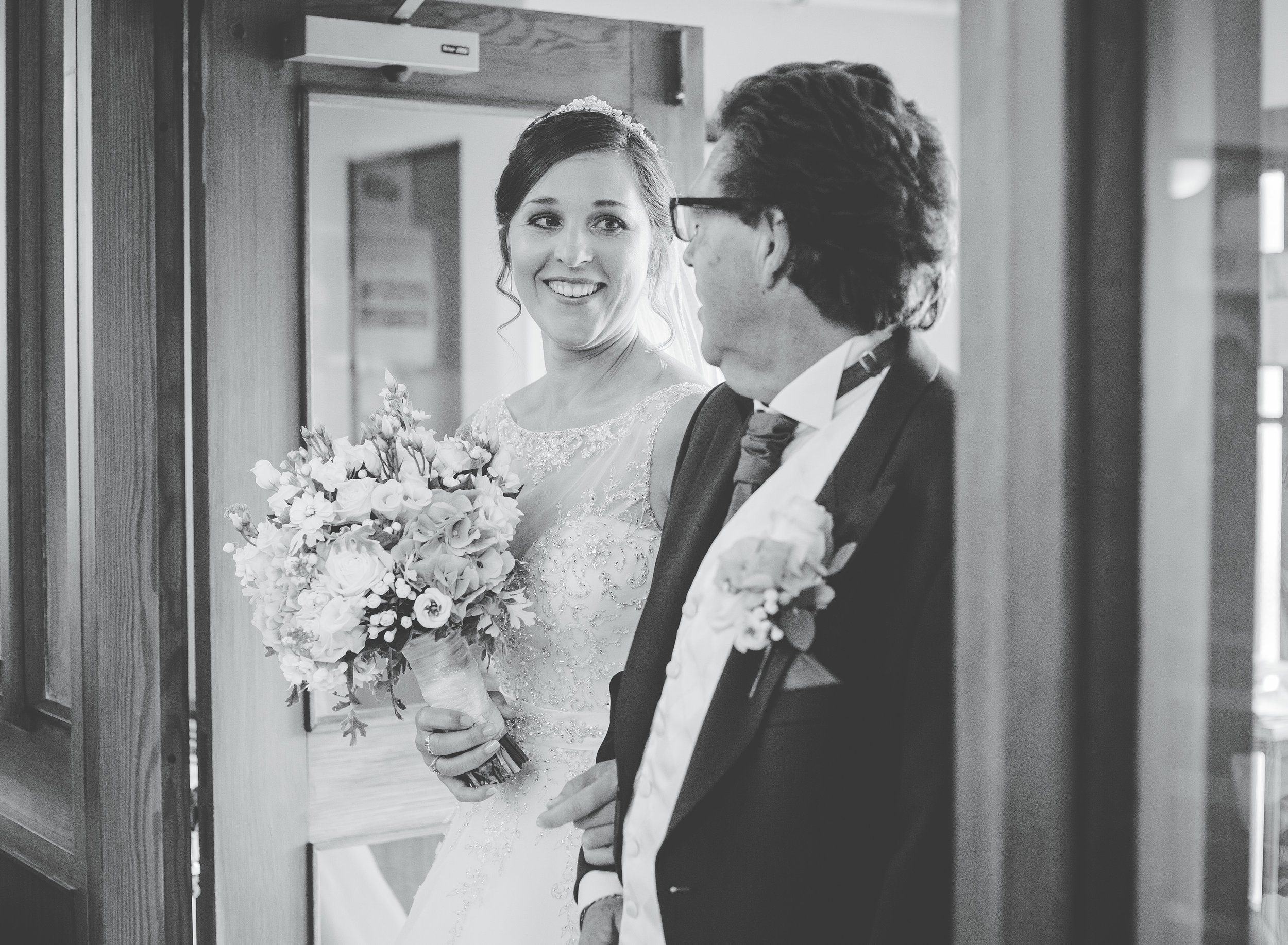 bride looks at dad - documentary wedding photography