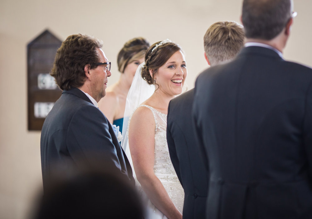 The bride and groom at the alter- Relaxed wedding photography