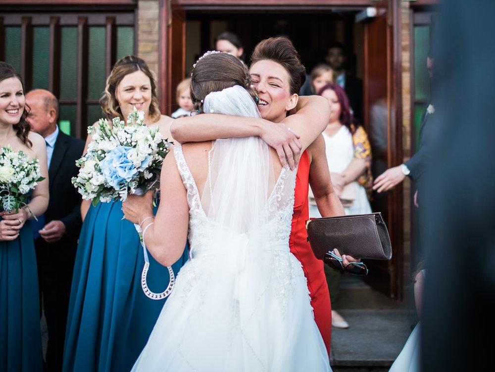 The bride hugging her wedding guests outside the wedding venue, The Villa at Wrea Green Preston