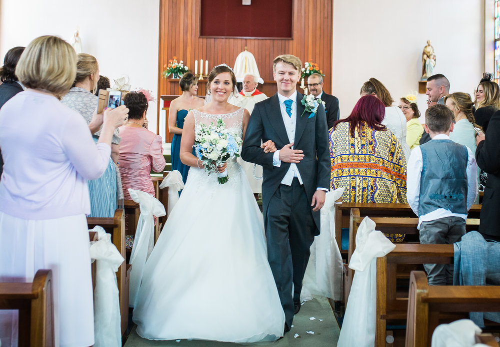 Bride and groom walking back down the aisle- relaxed modern wedding photography