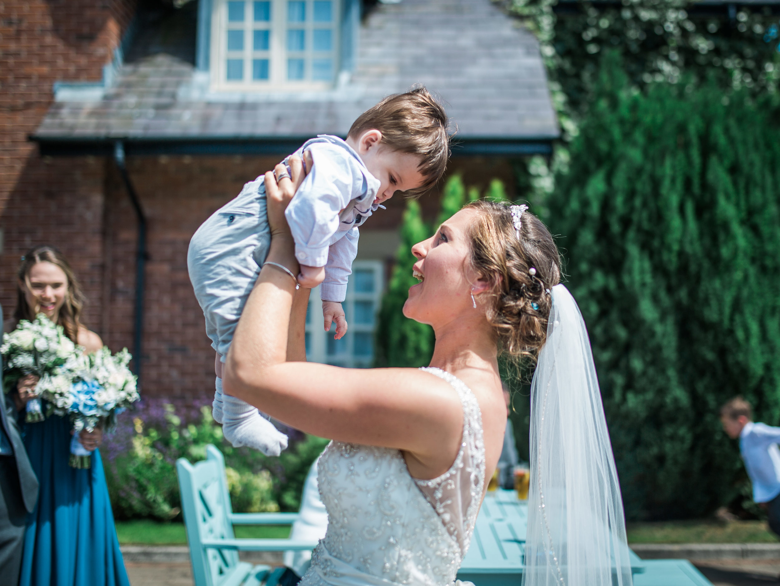 bride with baby - Lancashire wedding pictures