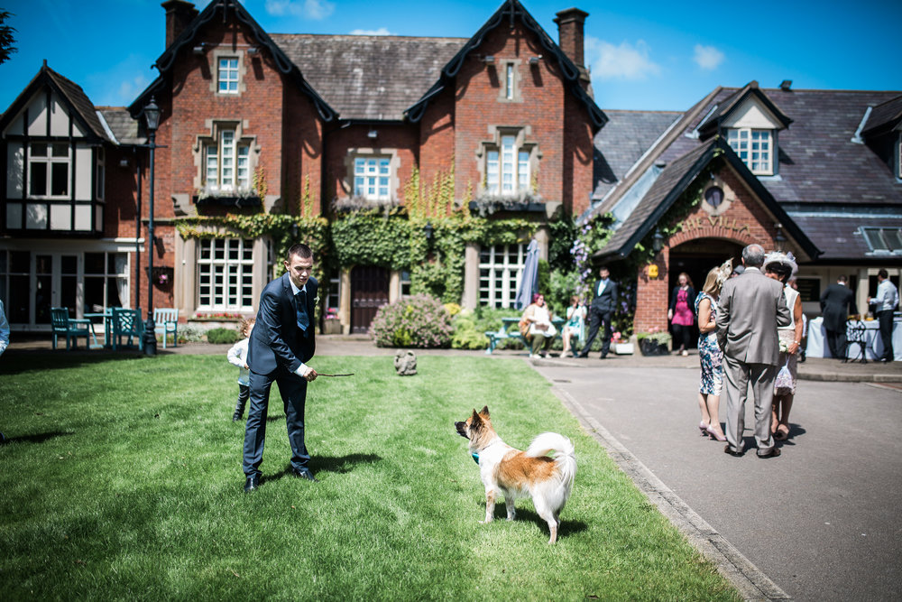 Weddings guests playing with the family dog- The Villa at Wrea Green Preston