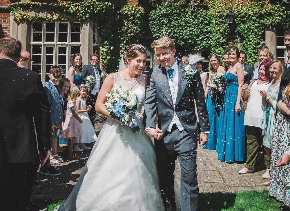 The bride and groom walking into the garden at The Villa at Wrea Green Preston