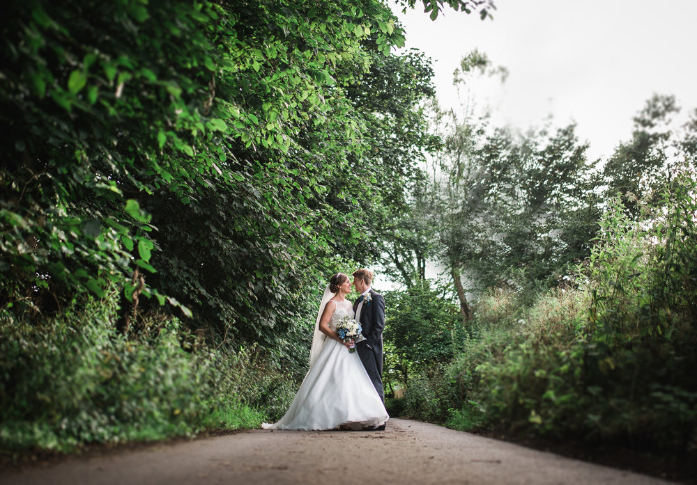 the newly weds in the distance- creative photography