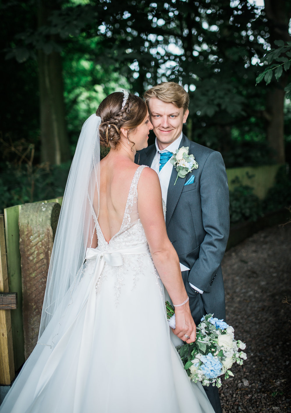 Portrait of the bride and groom amongst the trees- natural wedding photography
