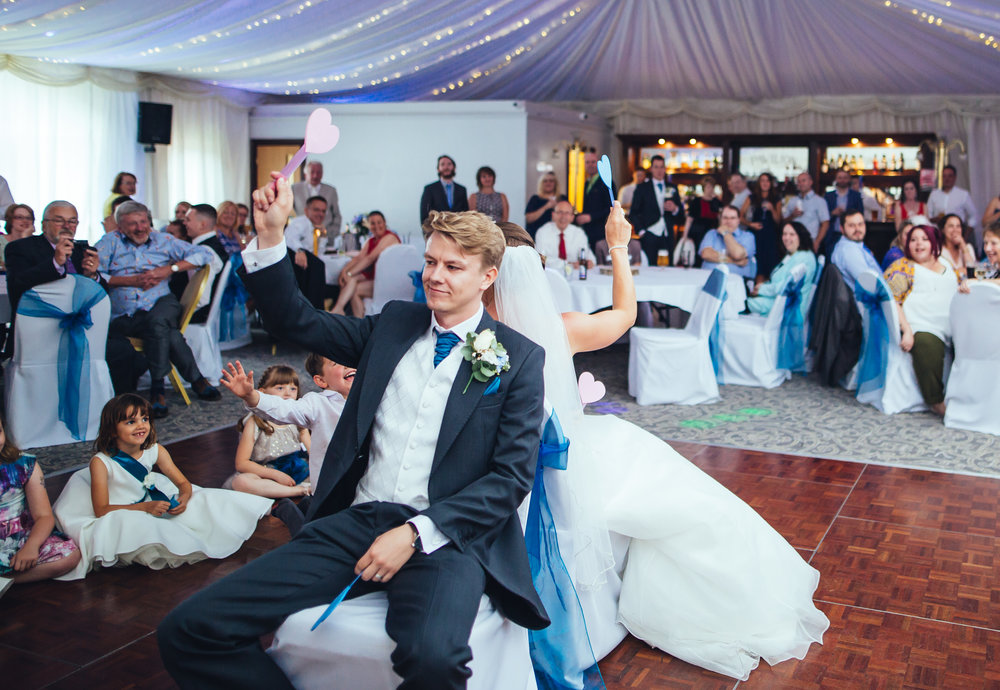 The bride and groom sat back to back- Documentary wedding photography