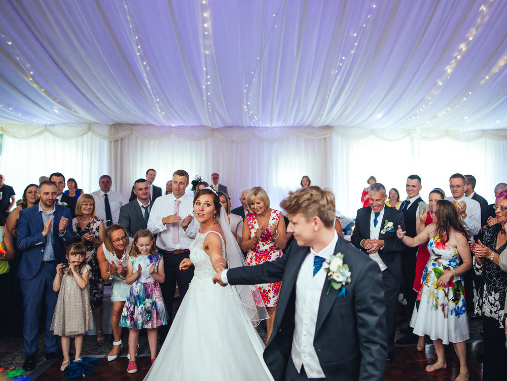 Dancing from both bride and groom- Relaxed wedding photographer
