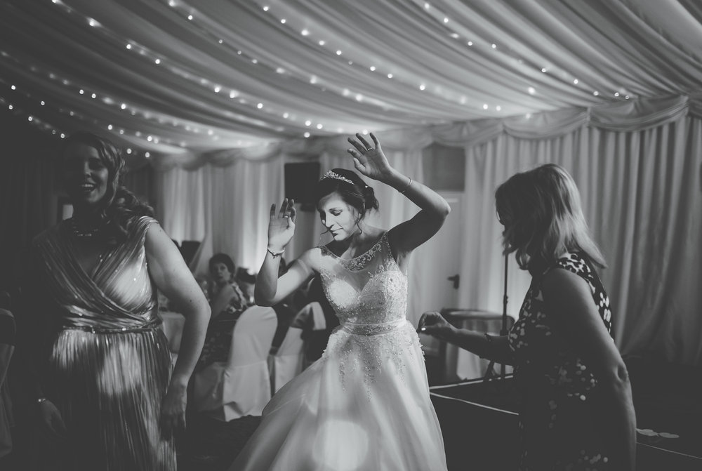 Black and white photograph of the bride on the dance floor- Documentary photography