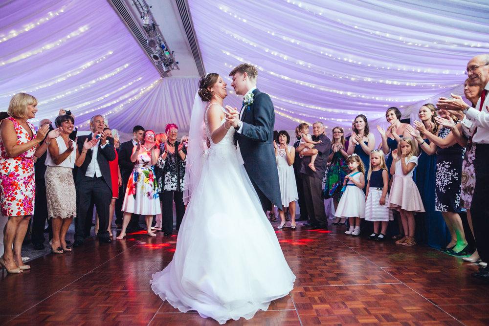 Both bride and groom on the dance floor, creative wedding photography