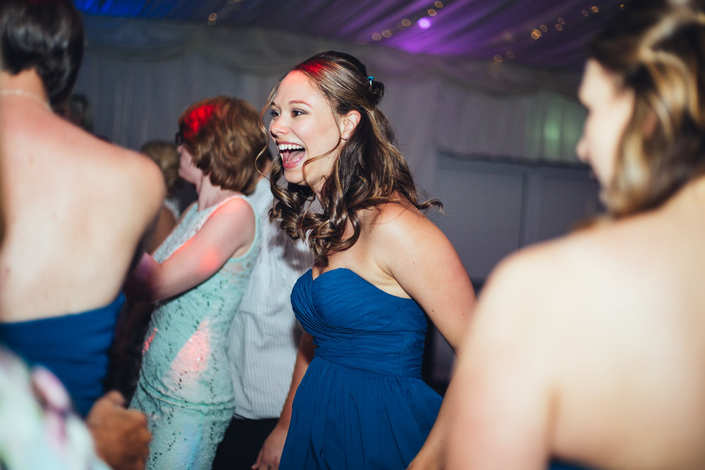 Big smiles from one of the cheerful bridesmaids- Documentary wedding photography in preston
