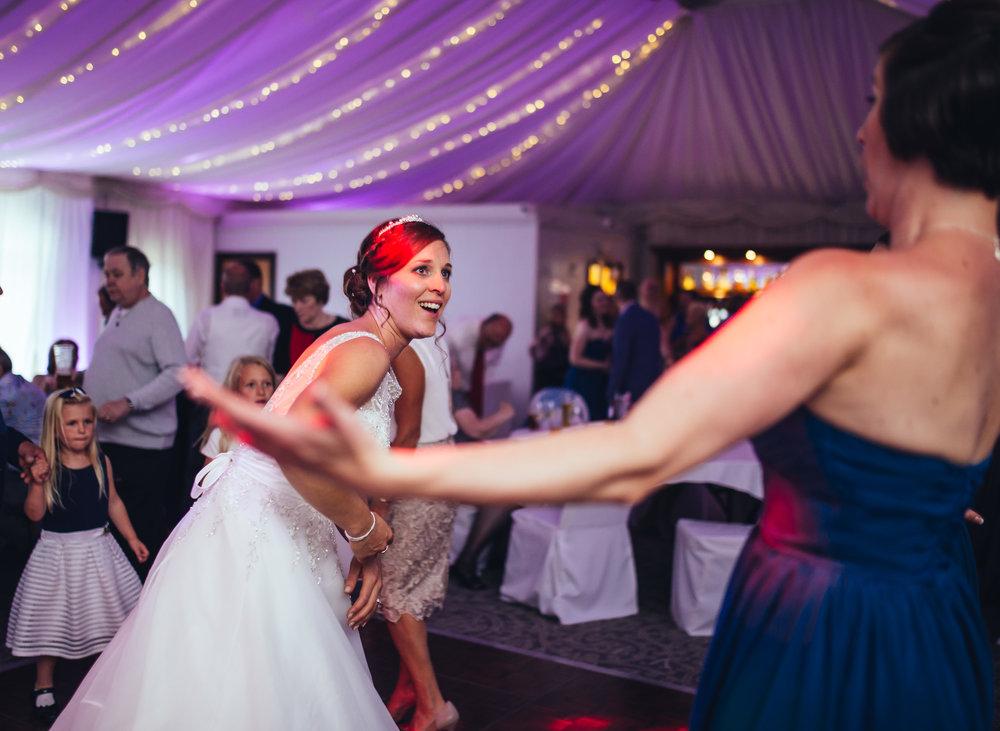 The bride and bridesmaids on the dance floor at The Villa at Wrea Green Preston