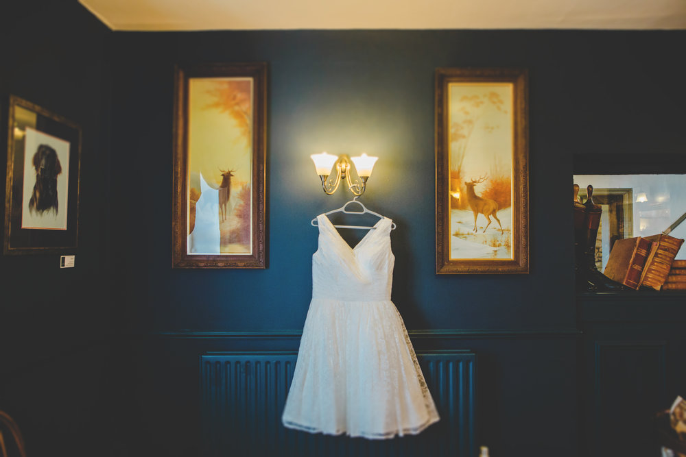 The bride wedding dress hung up- Ribble Valley wedding