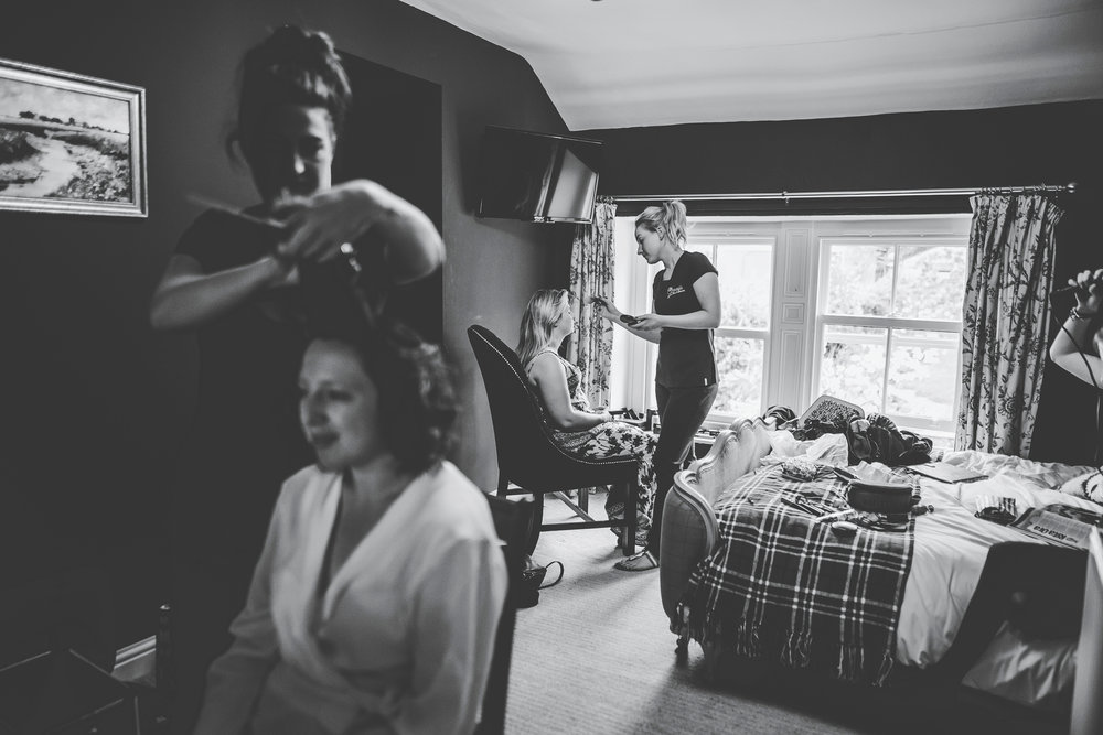Black and white photograph of the bride getting ready- Farm wedding photography