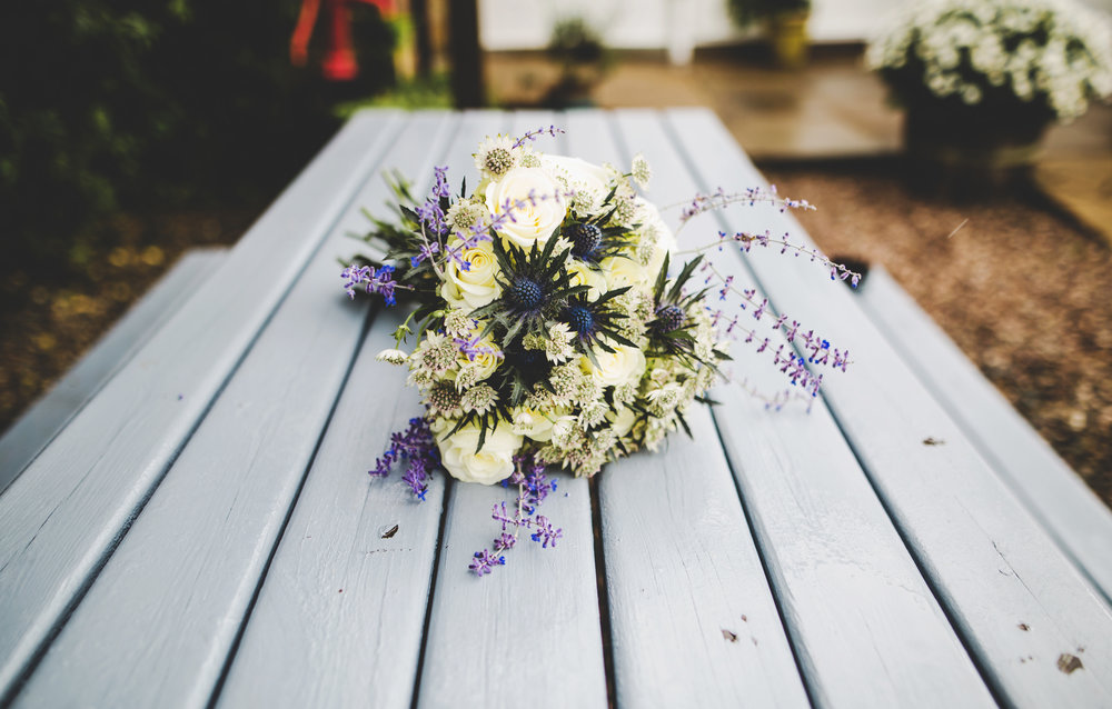 White and purple flower bouquet- wedding photography in lancashire