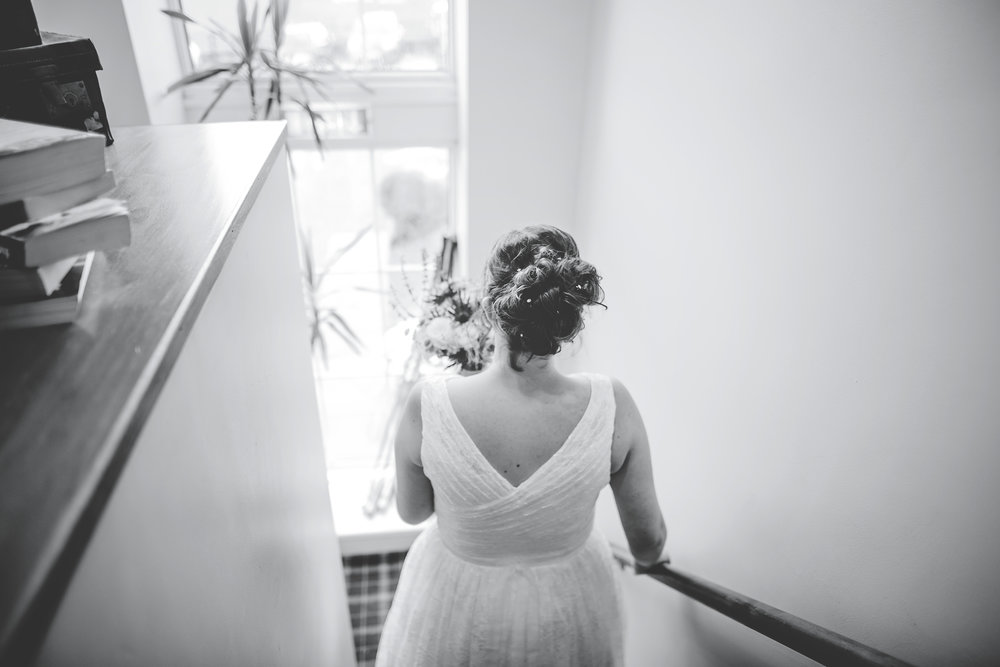 Photograph of the bride taken from behind- Documentary photography