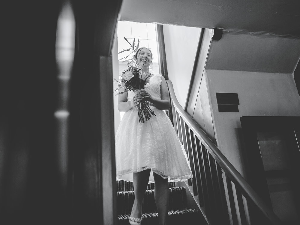 The bride walking down the stairs- Black and white documentary wedding photography