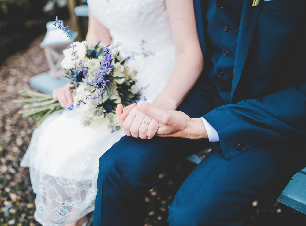 Close up of the bride and groom holding the flower bouquet- creative wedding photography in lancashire