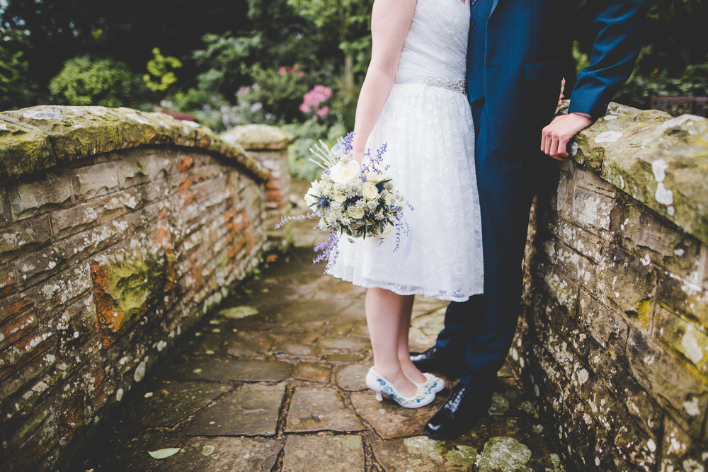 Creative photograph of the bride and groom on the bridge
