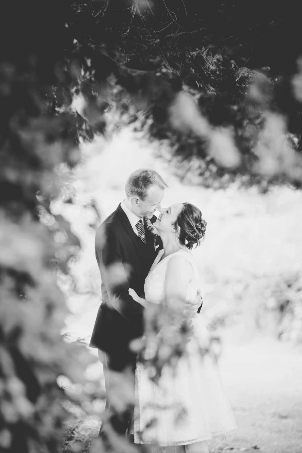 black and white portrait of the bride and groom amongst the trees- Documentary wedding photography