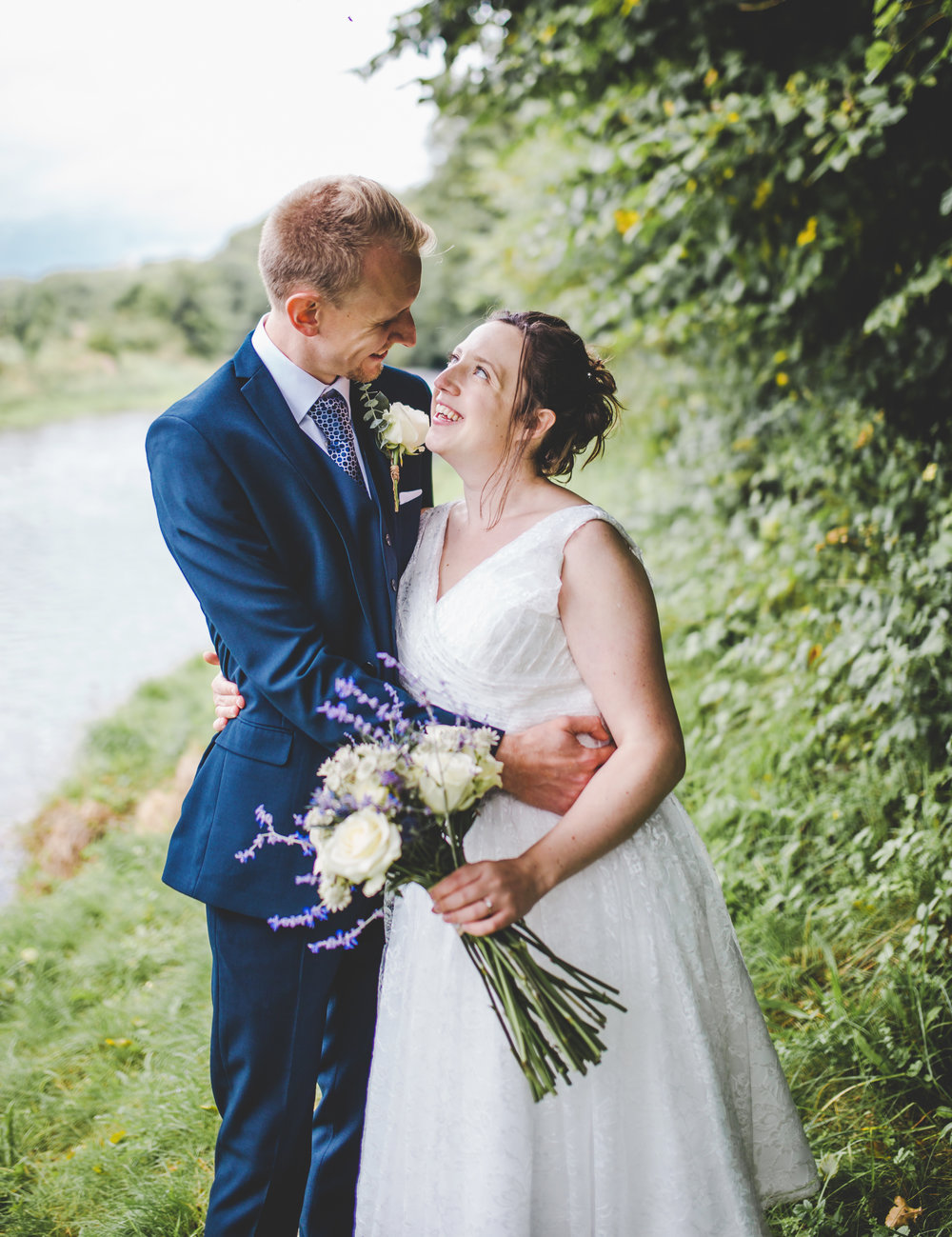 portrait of the bride and groom next to the river- Lancashire wedding photography, Bashall barn wedding