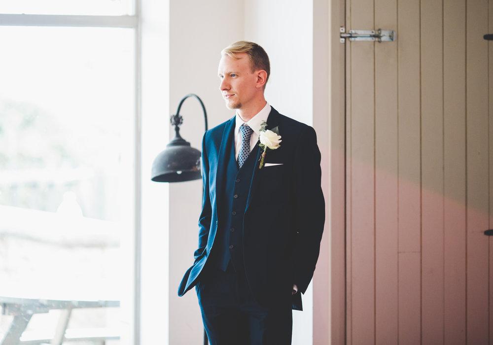 The groom stood in the Bashall barn.