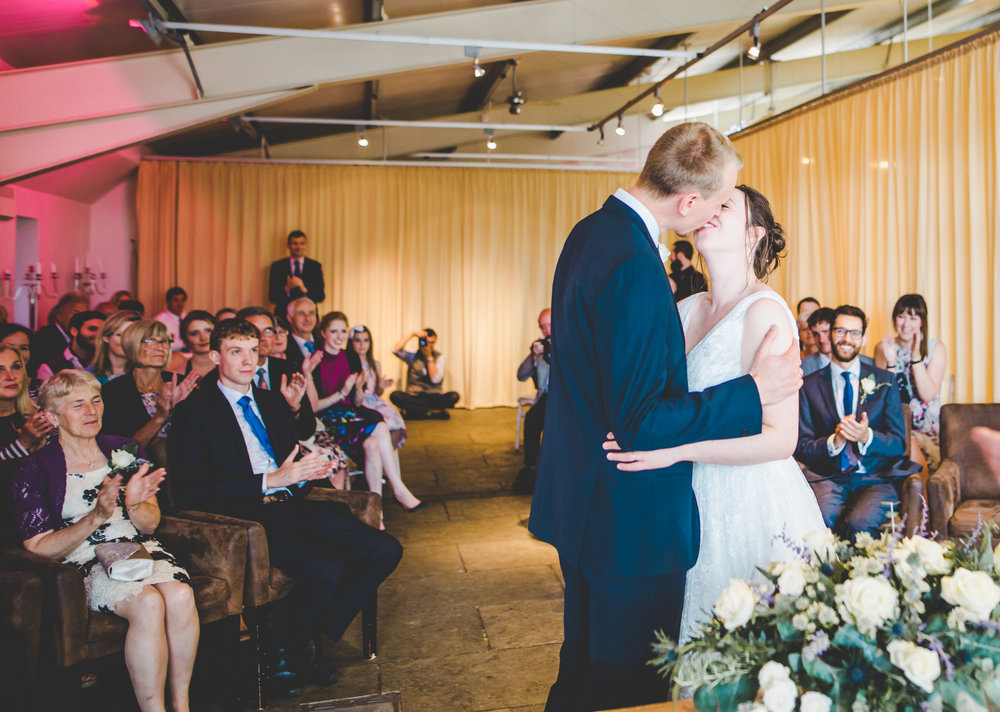 The newly weds kissing at the later- Bashall barn wedding venue