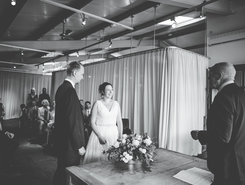Black and white photograph of the bride and groom at the ralter- documentary wedding photography