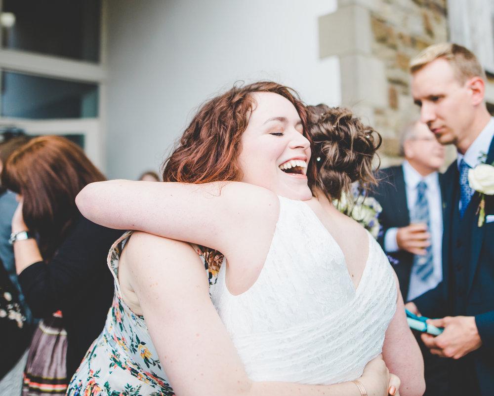 The bride hugging a wedding guest- lancashire wedding photography